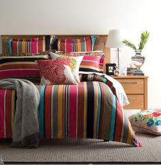 Make a bold statement with classic stripes in vibrant hues #bedroom #bedbathntable