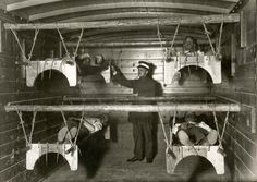 Temporary beds hanging in a train wagon for wounded soldiers, Netherlands, 1914