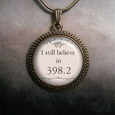 I still believe in 398.2 glass pendant, $12.50  (398.2 is the fairy tale section of the Dewey decimal system.)