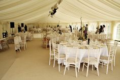 Simple pretty wedding marquee in ever-fashionable all white / cream