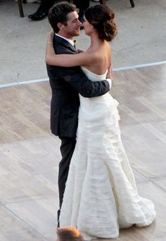 """When she wed Dave Annable, Odette Yustman walked down the aisle to the Beatles hit """"All You Need is Love"""" in a strapless Monique Lhuillier gown."""