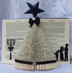 Christmas Tree Folded Book Art in .used Christmas Tree Folded Book Art in . Old Book Crafts, Book Page Crafts, Christmas Projects, Holiday Crafts, Paper Crafts, Book Christmas Tree, Book Tree, Christmas Paper, All Things Christmas