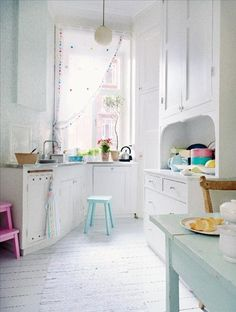 Love the gelato colours against the white.  I don't identify as a girlie girl - but this kind of interior always makes me feel good.