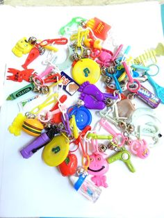 Plastic bell charms: I had a shit ton of these on a plastic chain. Some had working parts or ball point pens. We sometimes got them as awards at school. I wish i still had them!