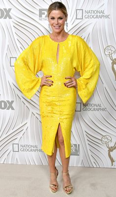 JULIE BOWEN traded her elegant black Alberta Feretti velvet column for a sunny yellow sequin Jeffrey Dodd sheath with full sleeves, plus Aldo heels and Sylvie & Cie jewelry, at the FX party.