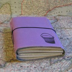 Best retirement gift EVER! bucket list journal with maps featured in Better Homes by BlueToad