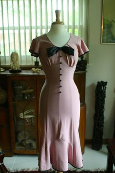 1940's style pink dress with black bow