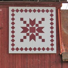 I like this: a barn quilt with a border! Step at a Time Barn Quilt
