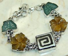 Carved Gemstone, Shell bracelet designed and created by Sizzling Silver. Please visit  www.sizzlingsilver.com. Product code: BR-7917