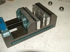 Vise Soft Jaws by jjr2001 -- The little v-groove in the Wilton drill press vise that I use for a milling vise is quite small. I wanted something a bit larger and also wanted some steps. I made these from aluminum and almost added magnets to them but after milling them and trying them in the vise it was apparent that they stand up just fine even when moving the vise jaw. I now have 3 steps. One step is the top of the aluminum and there are also milled into the jaws a 1/16 step and a 1/8…