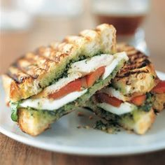 Paninis. Chicken, pesto, mozzarella, and whatever bread you like. I usually also add spinach leaves and sometimes tomatoes. Quick, easy, and delicious.