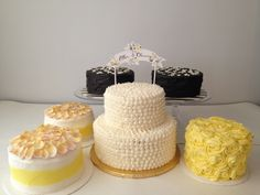 yellow and gray wedding cakes with candied flowers