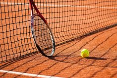 tennis court with tennis ball and tennis racket
