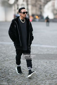Korean singer G Dragon, wears sunglasses, and a black jacket, outside the Vetements show at Centre Pompidou during Paris Fashion Week Haute Couture Spring Summer 2017, on January 24, 2017 in Paris, France.