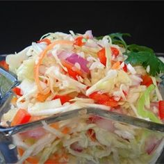 An absolutely delicious coleslaw, more tart and tangy than the creamy kind. It keeps well and can be made ahead of time.