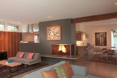abv architects modern remodel addition mid century - fireplace/countertop into kitchen
