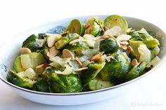 Brussels Sprouts with Toasted Almonds ~ Simple and delicious Brussels sprouts recipe with lightly steamed or boiled sprouts, mixed with sauteed onions, butter, and toasted almonds. ~ SimplyRecipes.com