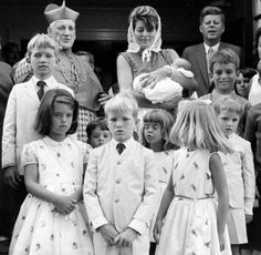 Baptism of Christopher Kennedy - with godparents Patricia Kennedy Lawford and John F. Kennedy. In front are various siblings/cousins including Maria Shriver (bottom left), Michael Kennedy (far right in white suit) and Joseph Kennedy Jr (just below the cardinal)