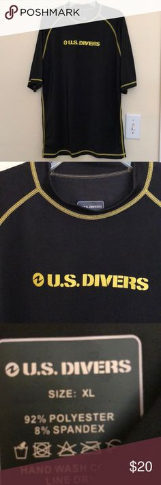 """Men's Rash Guard diving shirt by US Divers SZ XL Men's Rash Guard short sleeved diving shirt by U.S. Divers Size XL 92% polyester 8% spandex Armpit to armpit measures 20"""" Length from shoulder to hem is 26"""" (made to fit snugly) Black with yellow trim and lettering UPF 50+ sun protection EUC U.S.Divers Swim Rash Guards"""