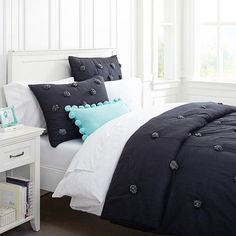 pom pom bed sheets | These bedding sets show that you can have a classic sense of design ...