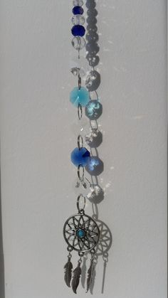 Blue rainbow maker crystal suncatcher with silver dreamcatcher & Swarovski crystal octagons -Boho hanging crystals with crystal beading. by ElementalRoseDesigns on Etsy