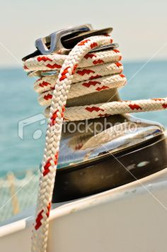 Stock photo of line wrapped around winch on a sailboat