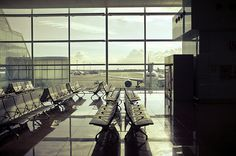 """So many of my childhood memories are intertwined with airports, so much of my life has been spent in random terminal buildings. The moment I enter an airport, I flick into autopilot and am embraced by a sense of familiarity and safety...Airports propel us onwards, to the next chapter of life. And in that motion, I find comfort. In the transition, I find home."" -Airports and Home"