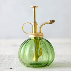 "In two terrain-exclusive shades, this glass bulb mister provides a gentle shower for humidity-loving terrariums, orchids, or ferns.- A terrain exclusive- Glass, brass- Holds 8 oz. - Imported6""H, 3.5"" diameter"