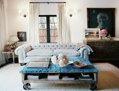 soft blue chesterfield sofa / coffee table on casters
