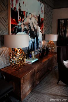 Lamps. Hand-crafted walnut credenza by Michael Coffey AND stunning custom hair-on-hide wallcovering by Kyle Bunting