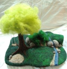 needle felted playmat by dragonflyducky on Craftster