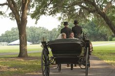 The bride and groom being whisked off in the Grand Oaks Resort's antique carriage featured in this article by @theknot. #wedding #carriage #antique #horses #Florida