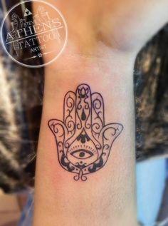 Small Hamsa tattoo by greek tattoo artist Steve Roumeliotis