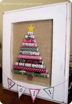 This is a great way to use Christmas paper scraps rolled and stacked to create a tree. Tutorial is online at The Simply Living Blog.