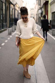 Long yellow skirt & heavy gold & silky updo & chunky knit & aviator sunnies & tan clutch= dream