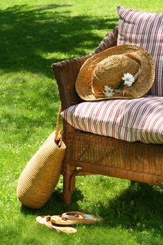 Enjoy the outdoors enjoying that summer feeling...hat. Flip flops. Bag of books!