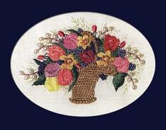 """Susans #Spring #Basket is filled with a lovely array of flowers created in #Brazilian #Embroidery.  The traceable pattern and fabric are included in the chartpack.  Finished design is 4"""" x 2.75"""".  #stitching  #needlework"""