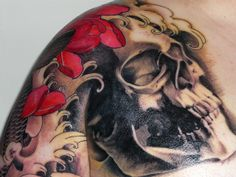 skull with asian waves tattoo