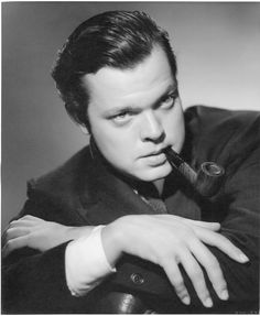 Orson Welles oversize gallery portrait for Citizen Kane by Ernest A. Bachrach.  Silver bromide matte 11 x 14 in. double-weight master print of Orson Welles with pipe for Citizen Kane (RKO, 1941), from the personal collection of the photographer. This is one of the most iconic, immediately recognizable and frequently reproduced portraits of Welles extant.