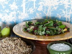 Spicy Greens and Pear Salad with Pomegranate Gremolata | This salad is the perfect blend of flavors—bitter (watercress, arugula), tart (pomegranate seeds) and sweet (honey and pear).