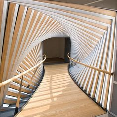 This architectural shot is magnificent. A hallway with amazing walls making it look like a vortex.