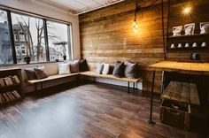 nice wall treatment for banquette area to pull the room together with fireplace feature wall in rustic wood also