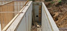 """The """"earth room"""" under construction.  Uses geothermal energy to condition air prior to HVAC."""