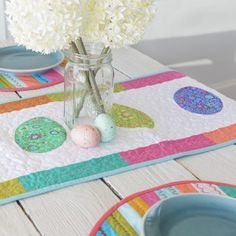 Quilted Easter Table Runner- Combine pretty prints and coordinating solids for this Easter Table Runner. Quilt in Coats Multi color Quilting thread #eastertabledecor #quilting #eastercrafts #multicolorthread #coatsandclark #makeitcoats