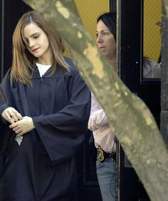 Emma Watson had an undercover armed guard with her during graduation ceremonies.