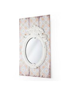E' in stile vintage questo specchio con cornice ralizzata da pannelli in legno…