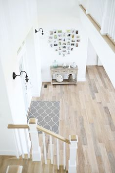 The foyer, like the rest of the house, feels bright and uncluttered. Hardwood flooring is from Phillips Floors. – MY WORLD Florida Home Decorating, Foyer Decorating, Modern Farmhouse, Farmhouse Decor, Coastal Farmhouse, Foyer Flooring, Floor Colors, California Homes, Decoration
