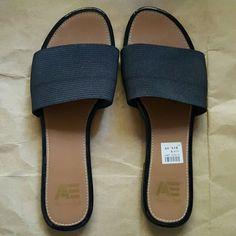 Lowest Price American Eagle Black Slides Black elasticized band. Slight black rubber heel. Worn twice. Size 9. American Eagle  Shoes Flats & Loafers