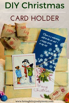 An adorable DIY Christmas Card Holder that is a fun Holiday Craft for any home. Perfect for seasonal home decor with a pallet look to it.