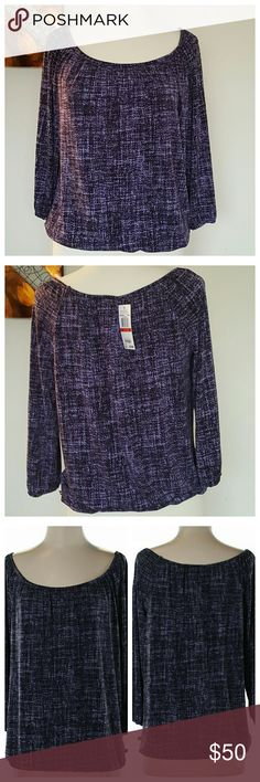 """New 💜 Michael Kors Black & Purple Top New with tags. Black & Purple pattern blouse by MICHAEL Michael Kors. Size small could fit medium. 23"""" Length. Elastic waist band. Scoop neck. Top has plenty of stretch to it. Material: 95% Polyester/5% Spandex. Michael Kors Tops"""